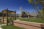 church, trellis, from behind brick site wall