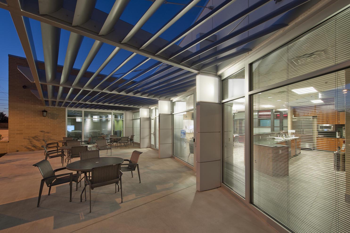 patio with metal trellis overhead