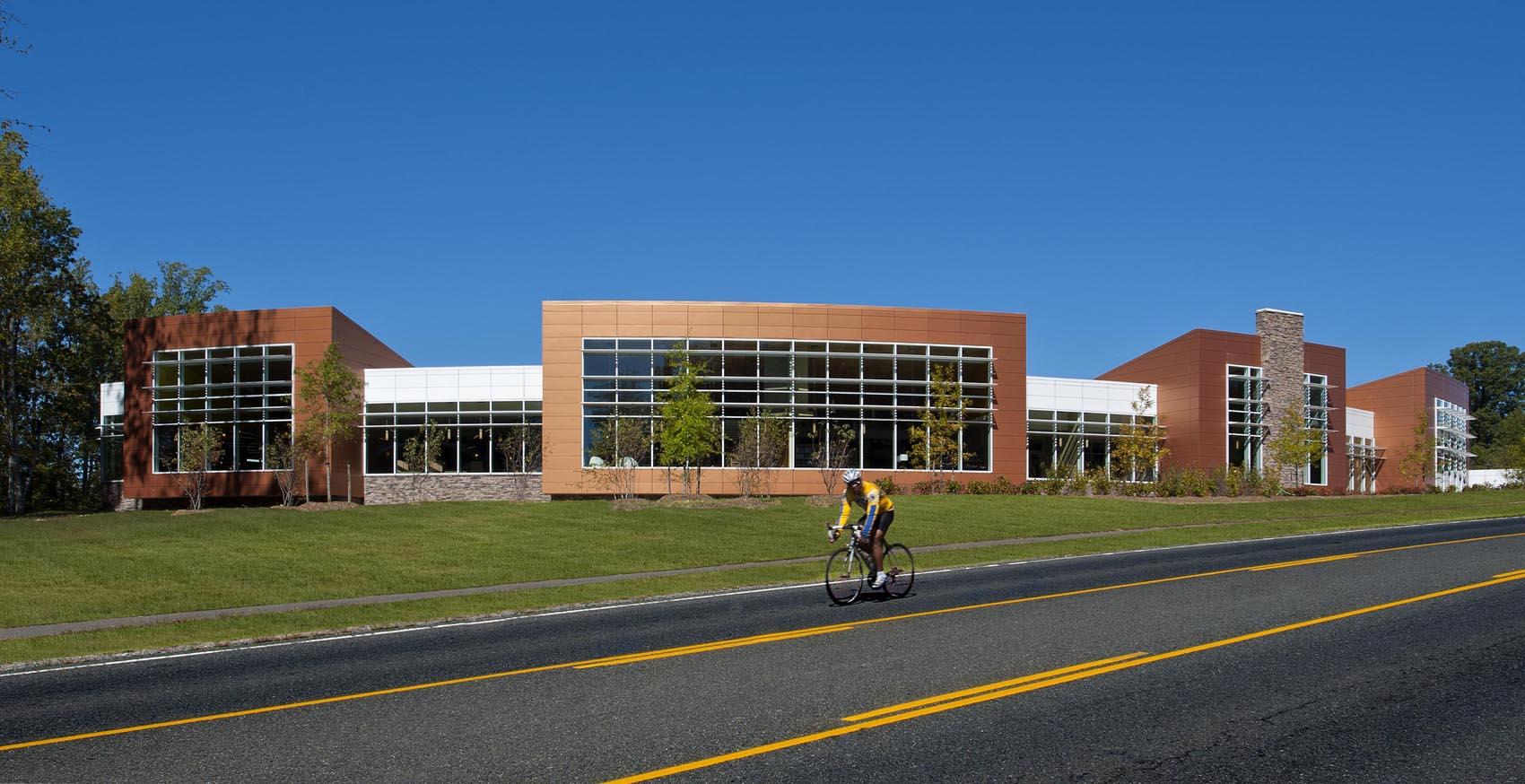 exterior of library with bike rider passing by