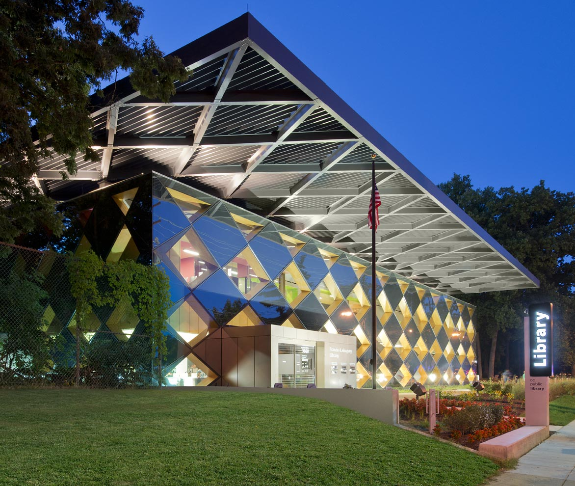 diamond-patterned library at night illuminated from within