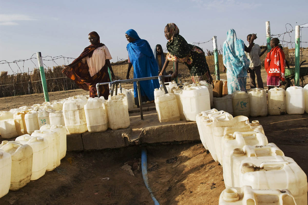 Women line up jerry cans for water at one of the few functional water points in the sprawling Kalma IDP camp.  As the Darfur conflict intensified, Kalma grew into one of the largest camps in the region.Kalma, Southern Darfur State