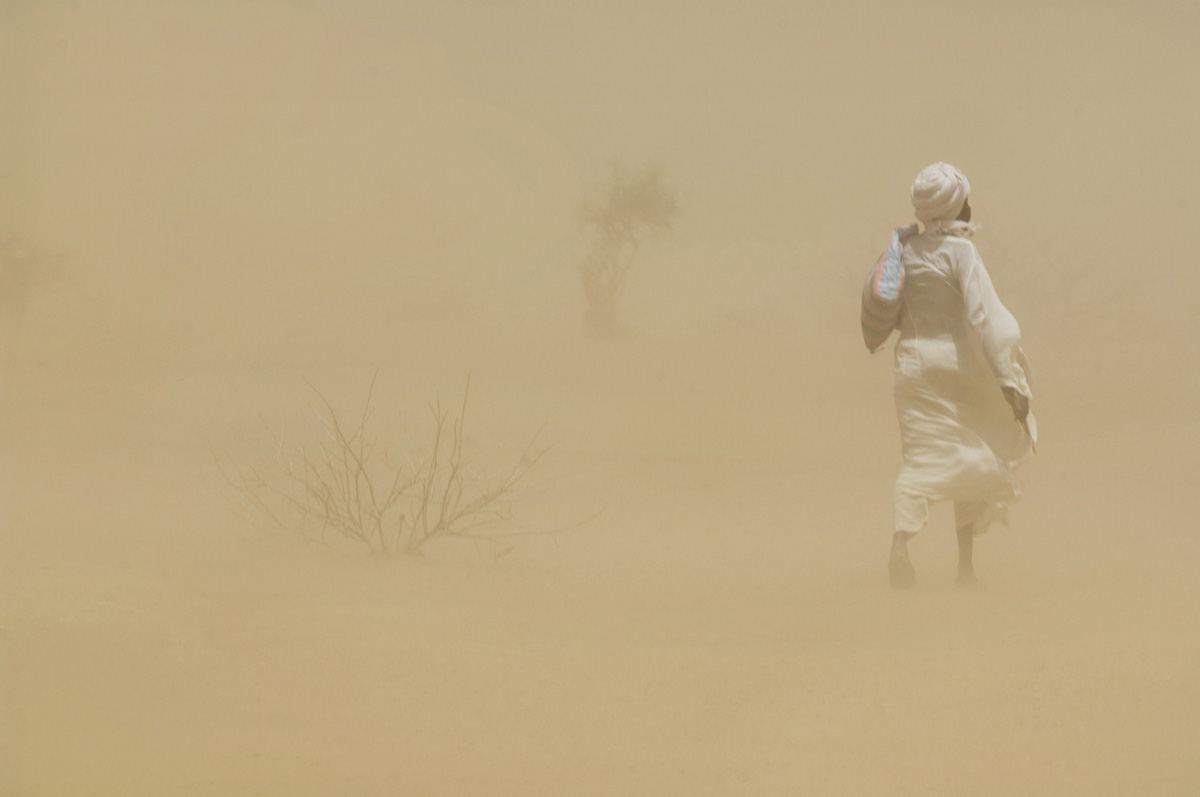 A man walks through a haboob (intense sandstorm typical in Sudan and other arid regions).Kulbus, Western Darfur State