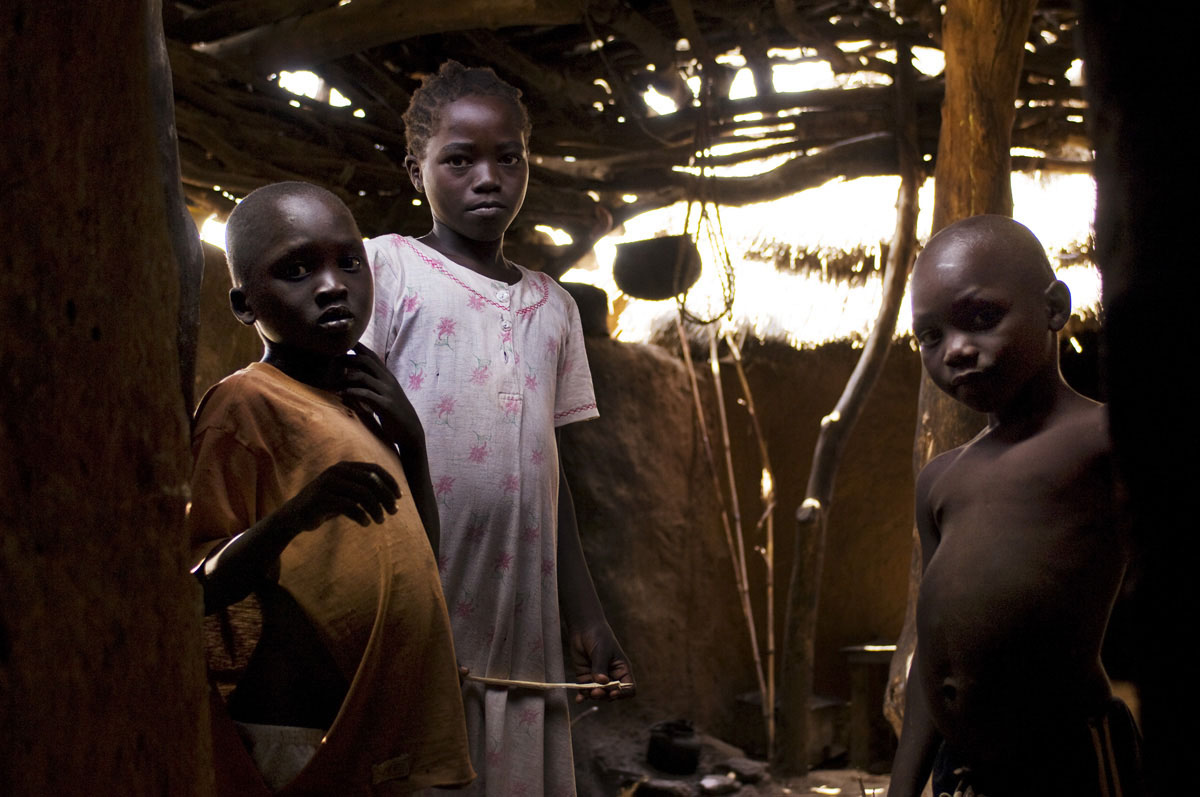 Young children stand in the kitchen of their homestead on the rocky hills of the Nuba Mountains.Kauda, Southern Kordofan State