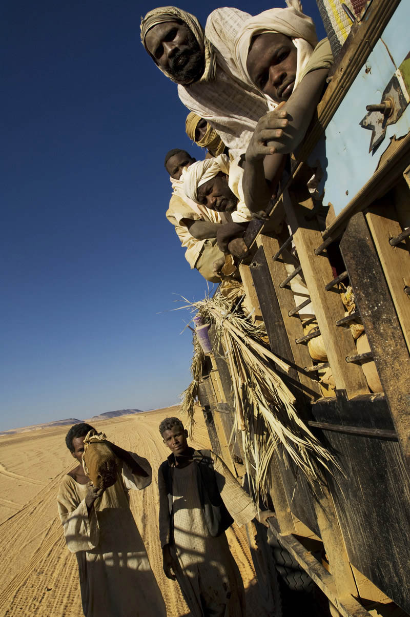 Migrant workers cross the Nubian Desert by truck in search of gold.  Recent discoveries of gold in the area around Atbara have brought prospectors from across Sudan seeking their fortune or at least a meager income.Nubian Desert, Nile State