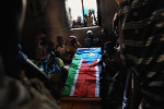 The family of SPLA Major Mabior Mading mourn over his casket at the family homestead.  Major Mading was killed during an attack on Duk Padiet village in Jonglei State days earlier.  The attack killed at least 160 people during a period of great insecurity across Southern Sudan and particularly in Jonglei State. Rumbek, Lakes State