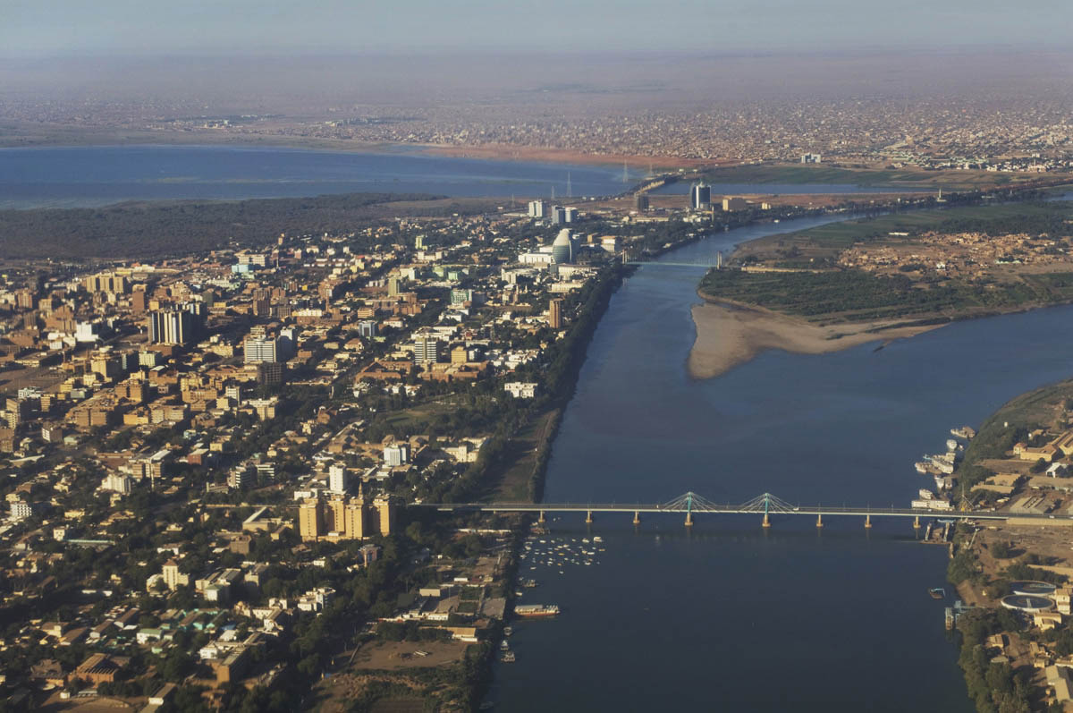 Aerial view of the 'three towns' of Khartoum (L), Omdurman (top) and Bahri (R) and the confluence of the White and Blue Niles.  Construction, particularly in Khartoum, has exploded during the CPA period.Khartoum, Khartoum State