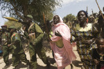 SPLA soldiers and their families parade during a visit by the Governor and Division Commander to their barracks near the border with Sudan.Timsaha, Western Bahr el Ghazal, South Sudan