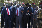 Senior members of the Government of Southern Sudan leadership including President Salva Kiir Mayardit (in hat) watch as Sudan President Omar Hassan al Bashir's plane departs Juba after a visit to the southern capital in the run-up to the referendum.Juba, southern Sudan