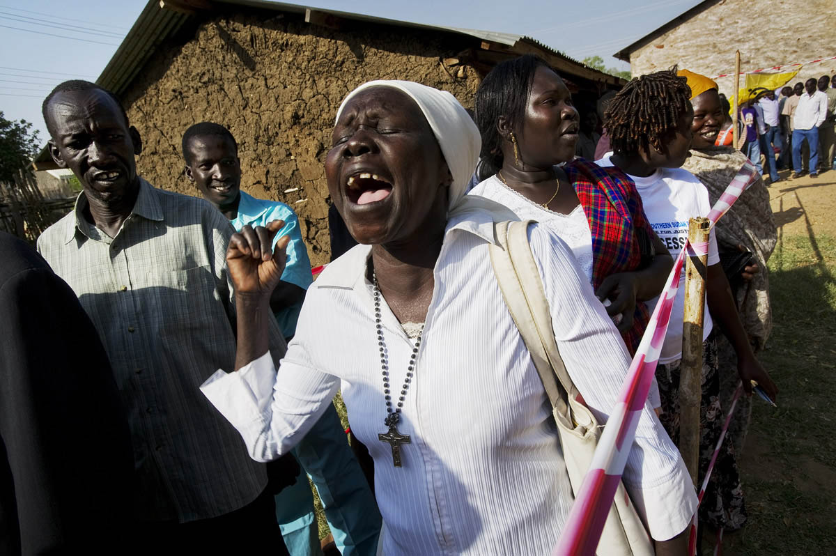 A woman ululates as she waits in line to cast her ballot in the long-awaited self-determination referendum.Juba, southern Sudan