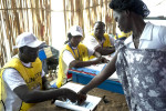 A voter places her thumbprint on the voting rolls before casting her ballot in the referendum.Malakal, southern Sudan