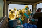 Dangerous work. A team prepares to carry out a safe & dignified burial of an Ebola victim.  Waterloo, Sierra Leone