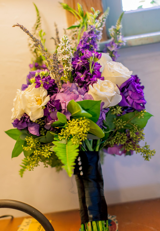A gorgeous, hand-tied bouquet of Roses, Hydrangea, Lisianthus, Lemon Leaf, Fern, and lavender...of course!