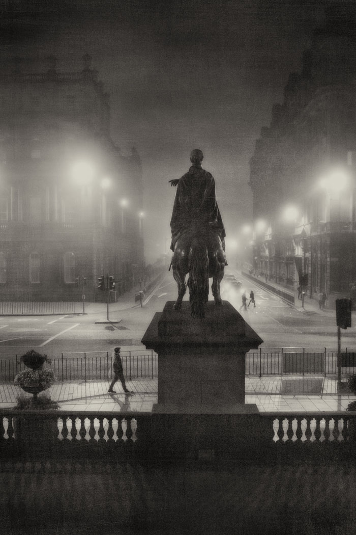 Duke of Wellington statue at the bottom of North Bridge Edinburgh on a foggy night.