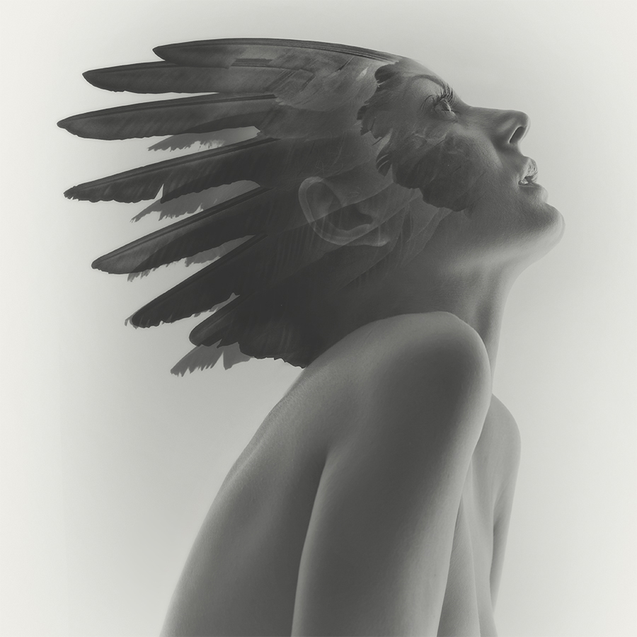 Double exposure female nude of Anna Lena with feather head dress