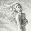 double exposure of a nude girl with ice. hair flowing