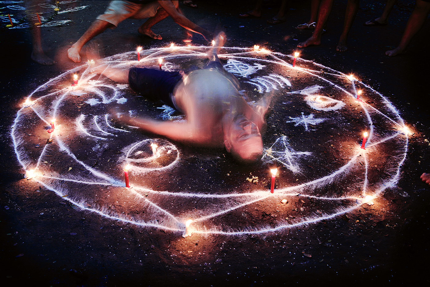 Writhing in convulsions, the power of the oracle brings this man into a trance as the spirit enters his body.