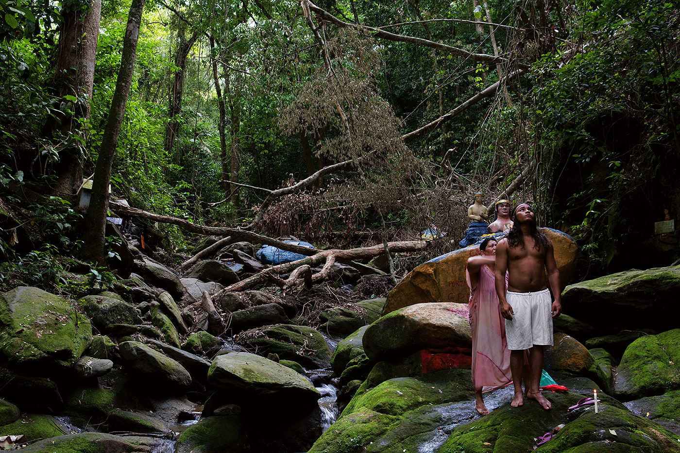 A mother prepares her son in a purification ritual to gather strength at the altar of the Indian Chief Gauicaipuro, whom led Venezuela's tribes against the conquest of the Spanish conquistadors and is revered among the Marialionceras.