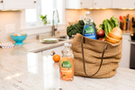 Seventh Generation product photography of orange Clementine Zest and Lemon Grass non-toxic dish liquid in a kitchen with groceries by Reciprocity Studio commercial photographers. Shot on location in Hinesburg, Vermont.