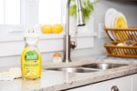 Seventh Generation product photography of yellow lemon non-toxic dish liquid in a kitchen Reciprocity Studio commercial photographers. Shot on location in Hinesburg, Vermont.