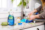 Seventh Generation product photography of blue Free & Clear non-toxic dish liquid in a kitchen Reciprocity Studio commercial photographers. Shot on location in Hinesburg, Vermont.