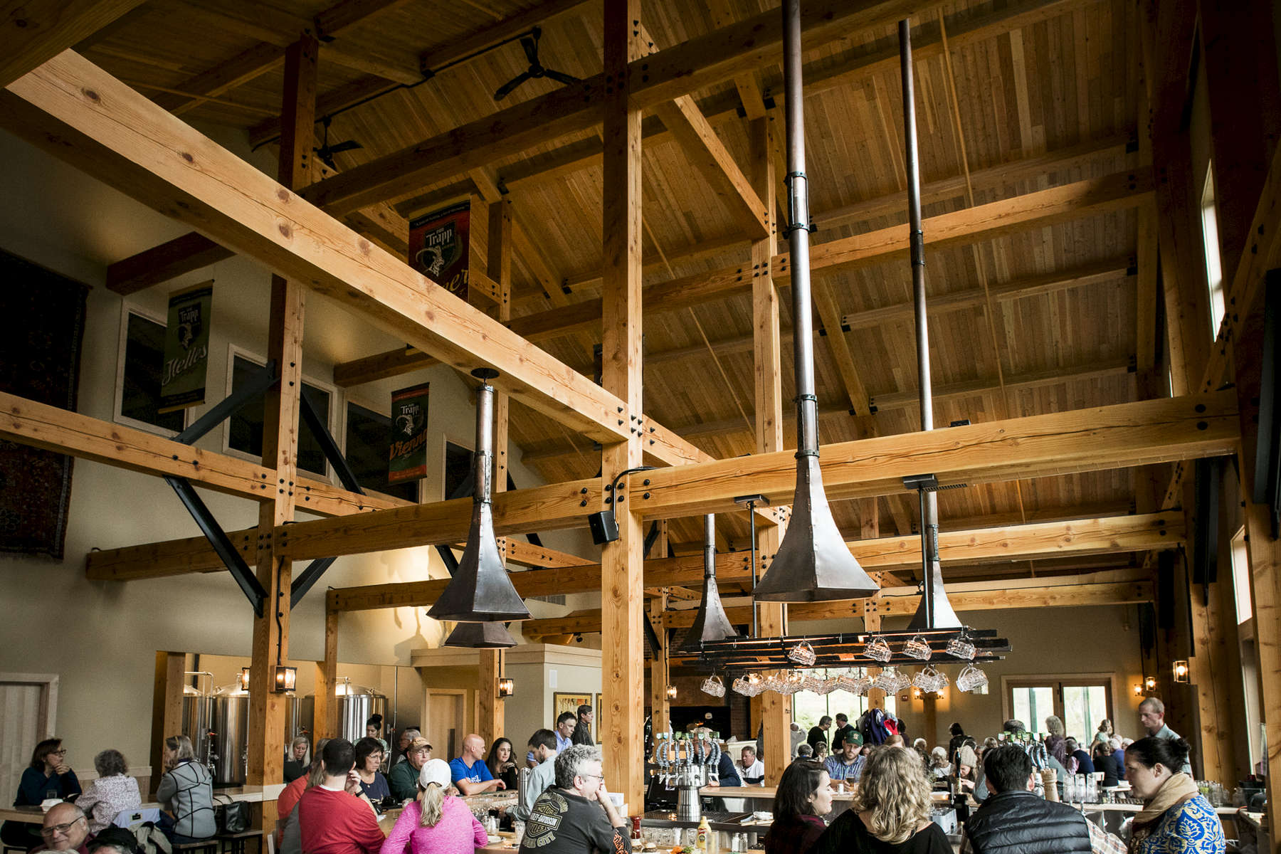 Exposed beam architecture at the Von Trapp Brewing Bierhall in Stowe Vermont.