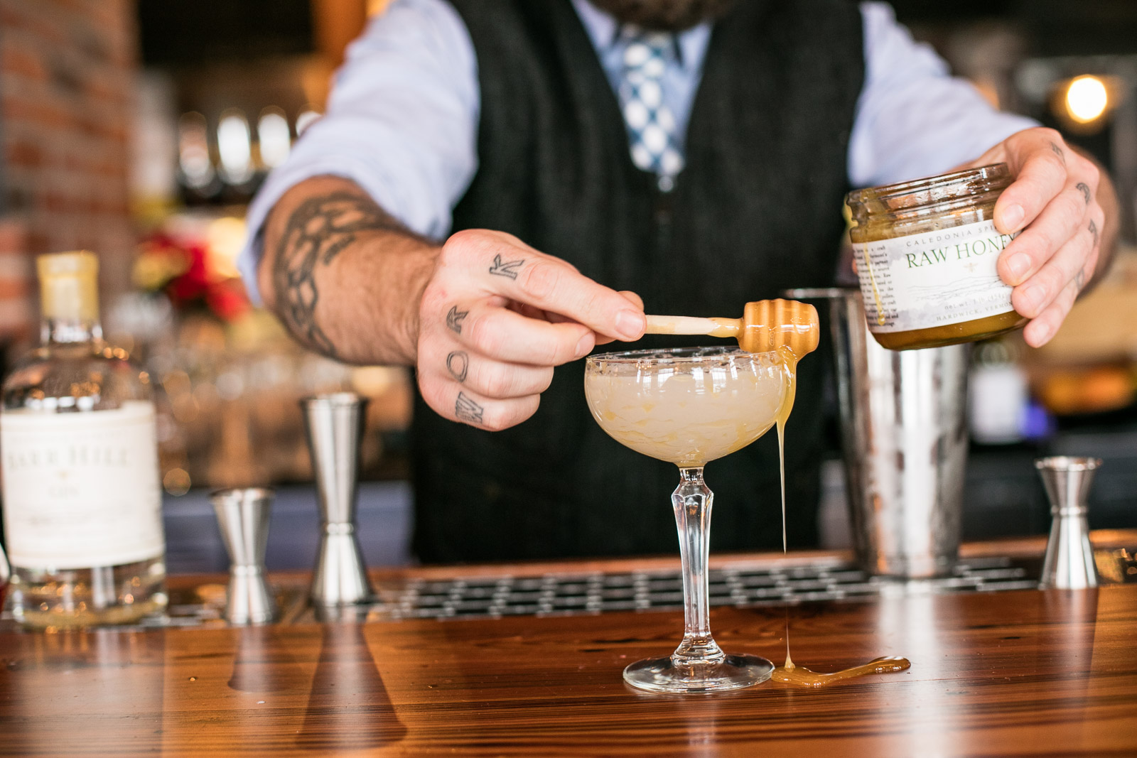 A bartender makes Caledonia Spirits cocktails at Waterworks in Winooski, Vermont. by Reciprocity Studio for Caledonia Spirits.