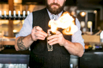 A bartender makes Caledonia Spirits cocktails with flame at Waterworks in Winooski, Vermont. by Reciprocity Studio for Caledonia Spirits.