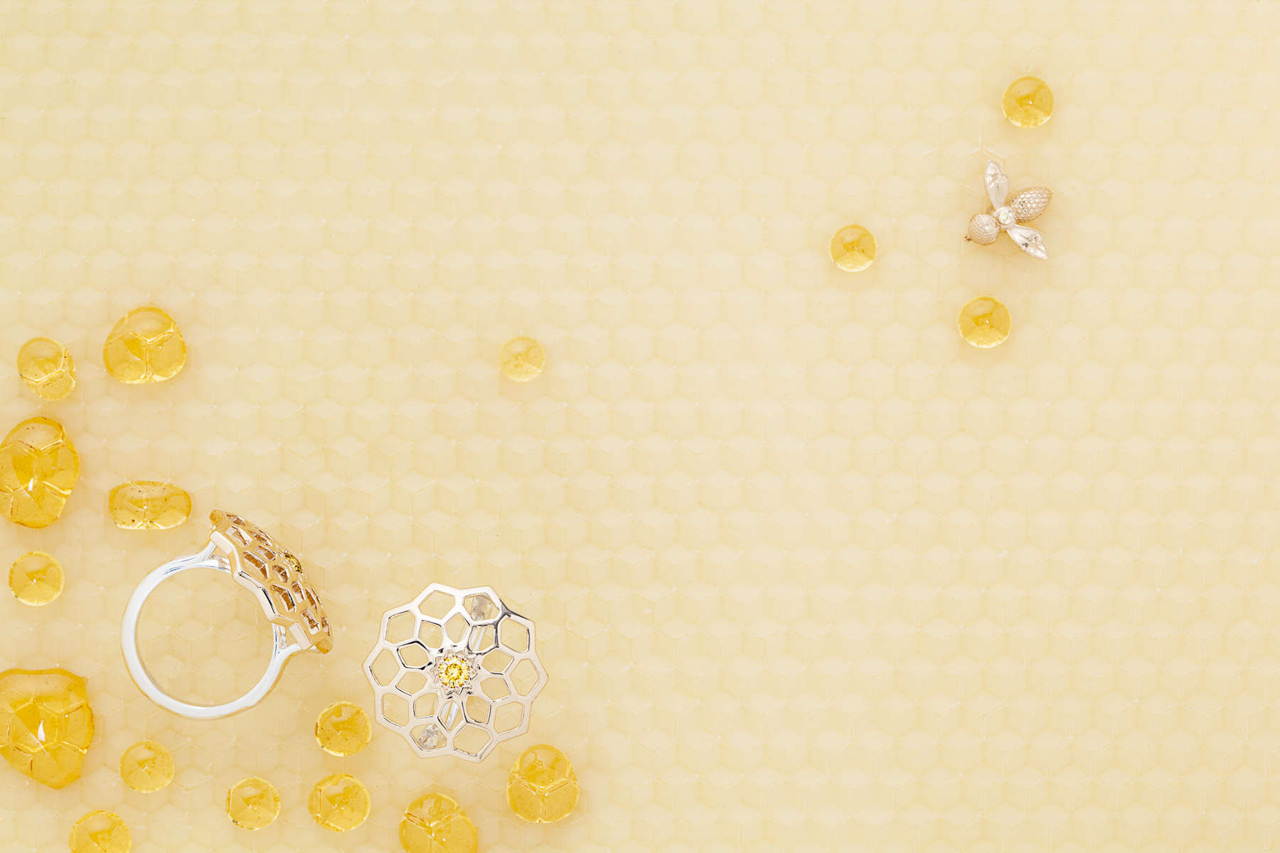 Jewelry photography with honeycomb and bees shot for Perrywinkles Fine Jewelers by Vermont photographers at Reciprocity Studio.