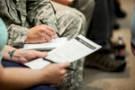 ROTC members fill out VSAC paperwork during a financial aid event - by photographers at Reciprocity Studio for the Vermont Student Assistance Corporation (VSAC)