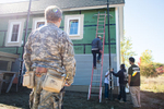 ROTC University of Vermont student watches a house building project near UVM by photographers at Reciprocity Studio for the Vermont Student Assistance Corporation (VSAC)