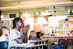 Students engage during class at Winooski Middle School. by photographers at Reciprocity Studio for the Vermont Student Assistance Corporation (VSAC)