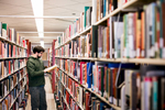 Studying at the University of Vermont library in Burlington, Vermont. by photographers at Reciprocity Studio for the Vermont Student Assistance Corporation (VSAC)
