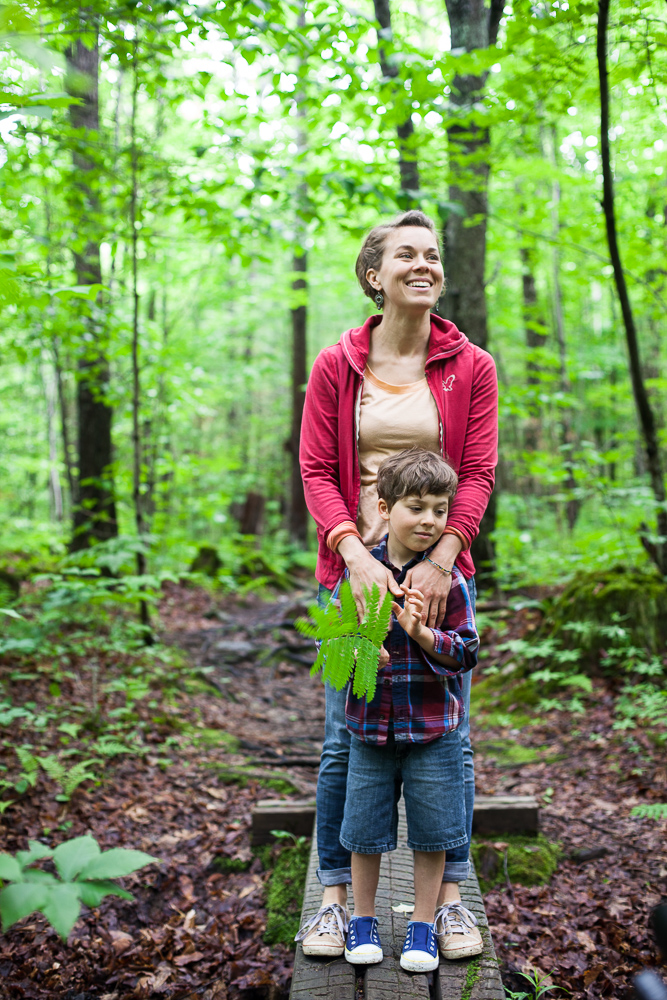 Mother and son walking through woods. by Vermont photographers at Reciprocity Studio, Burlington