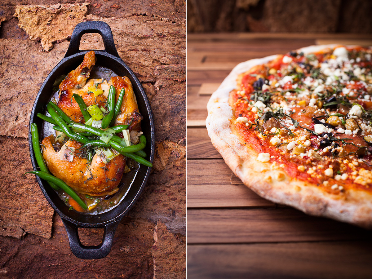 Chicken in cast iron dish and flatbread pizza at Nika Restaurant in Burlington, Vermont. by photographers at Reciprocity Studio