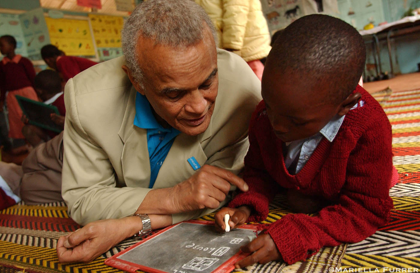 Unicef Goodwill Ambassador, Harry Belafonte, visits Kihumbuini Primary School in Kangemi, a poor neighbourhood in Nairobi.