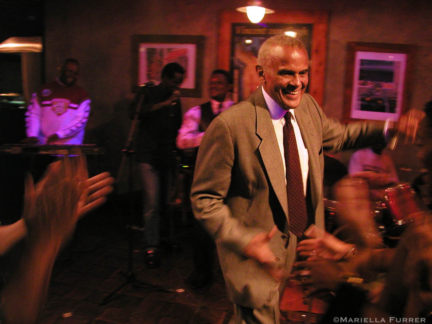 After having a bite a The Pavement, a restaurant in a suburb of Nairobi, Harry Belafonte, performs (two songs) for diners. Nairobi, Kenya.