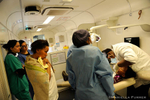 The dental clinic manager, Dr Saazi Guzi from Brackpan in SA, and his second year on the train, extracts a tooth from a young girl as students watch. The Phelophepa Health Train sponsored by Transnet Foundation, Roche, and Air Liquide stops at Wincanton in the Northern Cape to provide services to surrounding areas. The train has a dentist carriage, Optomitrist carriage, and Psychology carriage. 40 Students arrived today for two weeks. Psychology and Optometry Students are from University of KwaZulu Natal. Nursing Students are from University of Johannesburg and Dental Students are from University of Witwatersand in Johannesburg.