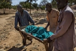 Africa, Sudan, South Kordofan. 26th Nov 2013. Mother of Mercy Hospital of Ghidel , the only hospital in South Kordofan , with a capacity of 400 beds but the last year has already welcomed more than 30,000 patients. A wounded woman is carried to the hospital. Africa, Sudan, Kordofan Meridionale. 26 Novembre 2013. L'ospedale Mother of Mercy di Ghidel, l'unico ospedale dele South Kordofan, con una capacità di 400 posti letto ma che nell'ultimo anno ha già accolto oltre 30000 pazienti. Una donna ferita viene trasportata in ospedale.