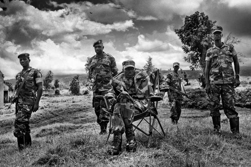 Africa, R.D.C.- North Kivu, Rutshuru. Brigadier General Sultani Makenga (seated) of the newly formed Congolese Revolutionary is seen in Rumangabo military camp (Bunagana), Democratic Republic of Congo. The M23 Movement, the newly formed political wing of former M23 rebels, has formed a semi autonomous administration structure in areas under their control in north Kivu province in the DRC. 15th October 2012.©Marco Gualazzini/Getty Images Grants for Editorial Photography Recipient 2013.