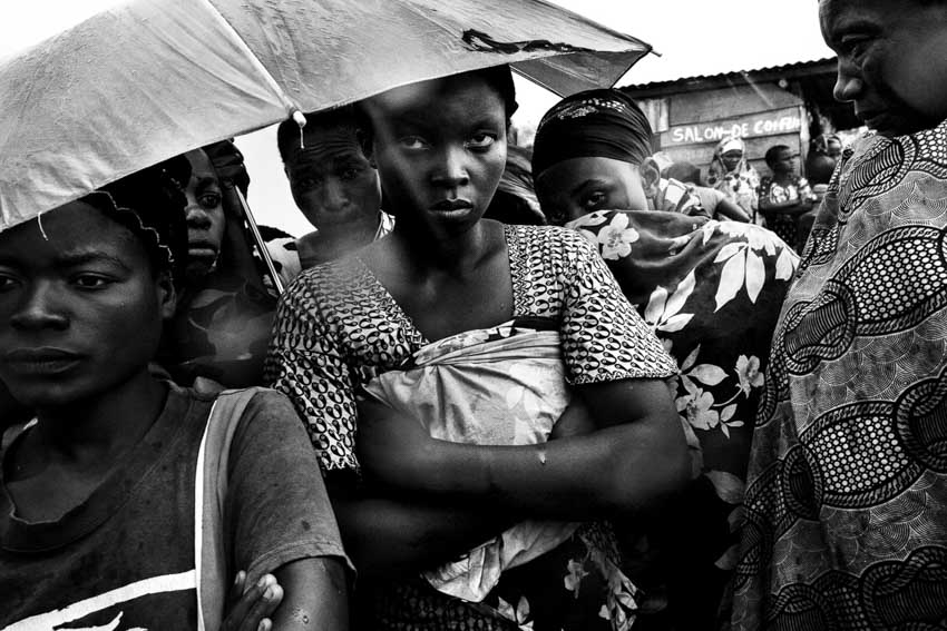 Africa, R.D.C.- North Kivu, Goma. Out of fear of the take-over of Goma by M23 rebels, Thousands people (767,000 have been displaced in the east of Congo since April following the outbreak of war between the M23 rebel movement and the FARDC) fled to refugees camps Mugunga 1 and 3. Many people in this sites say they have witnessed shocking scenes of violence with people being burned in their homes and decapitated. Internally displaced Congolese wait for food to be distributed by WFP at the Mugunga 3 camp outside the eastern Congolese town of Goma. 26th November 2012©Marco Gualazzini/Getty Images Grants for Editorial Photography Recipient 2013.