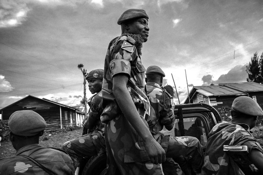 Africa, R.D.C.- North Kivu, Goma. FARDC, the troops of the government army. Underpaid and without sufficient means, the soldiers at the forefront of the fighting live in tent cities with their families, while those further back and in the city are often guilty of banditry, corruption and violence. Military police patrol the city of Goma. 23rd October 2012.©Marco Gualazzini/Getty Images Grants for Editorial Photography Recipient 2013.