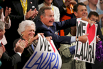 DIGITAL: LWB 2220 Laura Bush: Speech to the Republican National Convention. Madison Square Garden. New York City. Former President George H.W. Bush (41) and former First Lady Barbara Bush hold up \{quote}We love Laura\{quote} signs. Lois and Roland Betts. Bush Family Scrapbook August 17, 2004 - September 4, 2004 RELEASED TO: Kessler for a book on First Ladies, 080505
