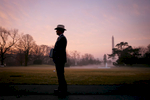 President Bush en route to the Oval Office. South Lawn. Sunrise. Cowboy hat.Bush Family Scrapbook