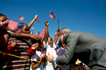 President Bush: Visit to Waldo C. Falkener Elelmentary School. Greensboro, North Carolina. Students wave American flags.President George W. Bush greets flag-waving students at the Waldo C. Falkener Elementary School Wednesday, Oct. 18, 2006, in Greensboro, N.C., where he delivered remarks on the No Child Left Behind Act. White House photo by Paul Morse  POW