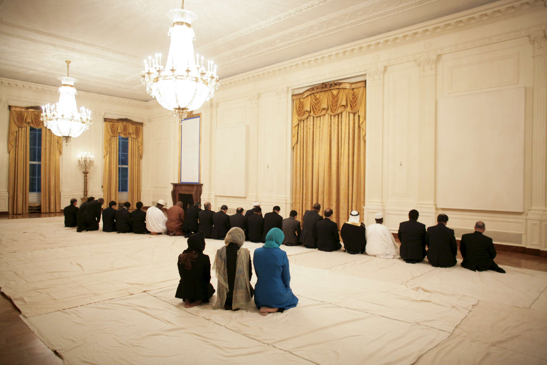 President Bush: Iftaar Dinner with Ambassadors and Muslim Leaders. State Floor. Guests pray in the East Room.
