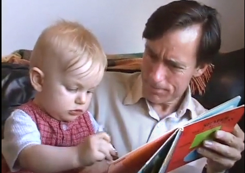 © Joe Gibbons aand Emily BreerJoe reads to young girl/toddler