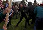 A Trump supporter who preferred not to give his name trades blows with a masked anti-fascist protester during a pro-President Donald Trump rally and march at the Martin Luther King Jr. Civic Center park March 4, 2017 in Berkeley, Calif.