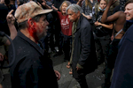 A pro-Trump supporter, left, stands with his fellow supporters and exchange words with anti-fascist protesters, right, after a skirmish on Center and Shattuck streets after a rally called {quote}Patriot's Day Free Speech Rally{quote} in Martin Luther King Jr. Civic Center Park became violent  April 15, 2017 in Berkeley, Calif.
