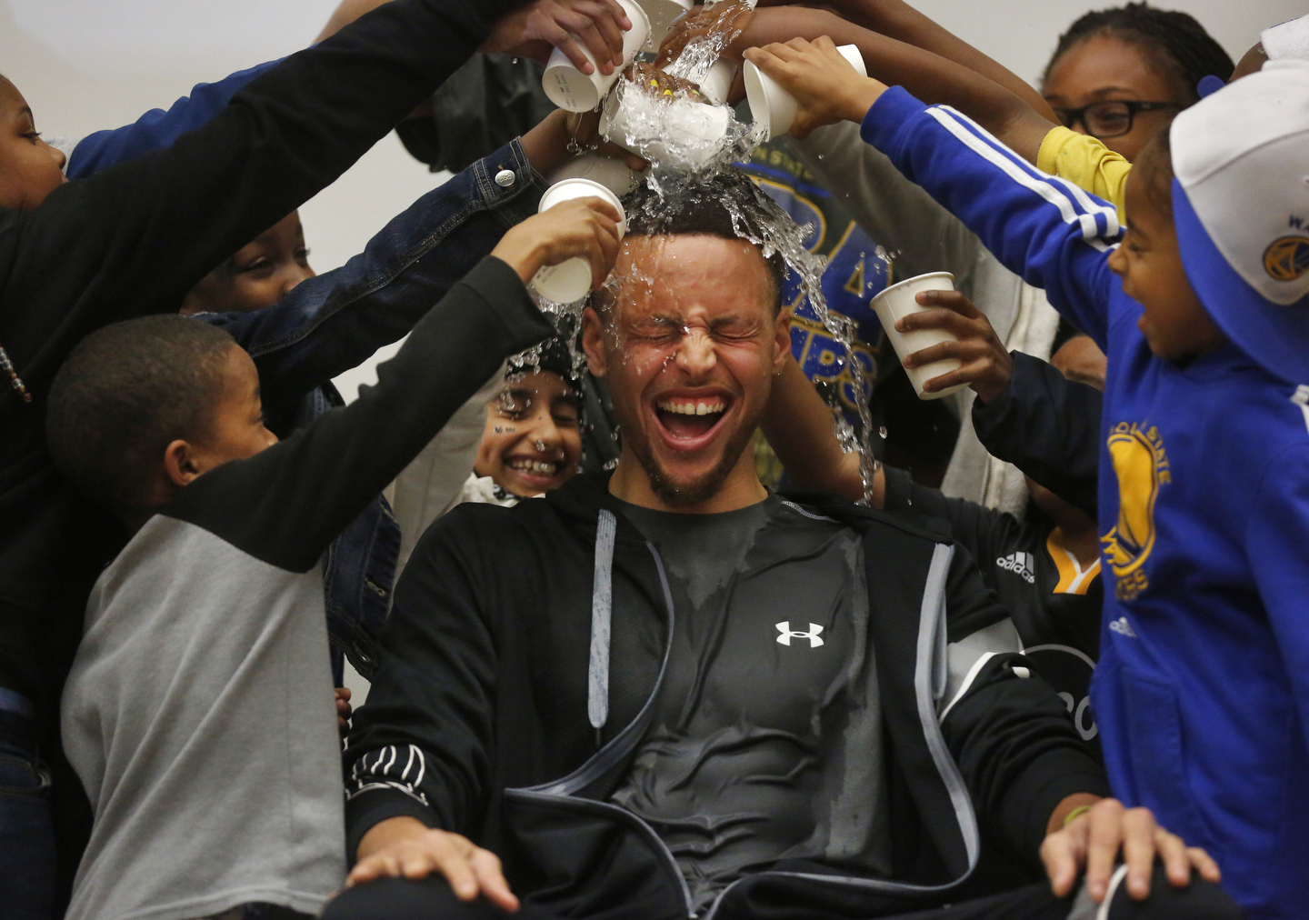 Students pour water onto Stephen Curry's head during an event at Martin Luther King Jr. Elementary School wherein Curry promoted drinking water and healthy eating in partnership with his sponsor Brita March 8, 2016 in Oakland, Calif.