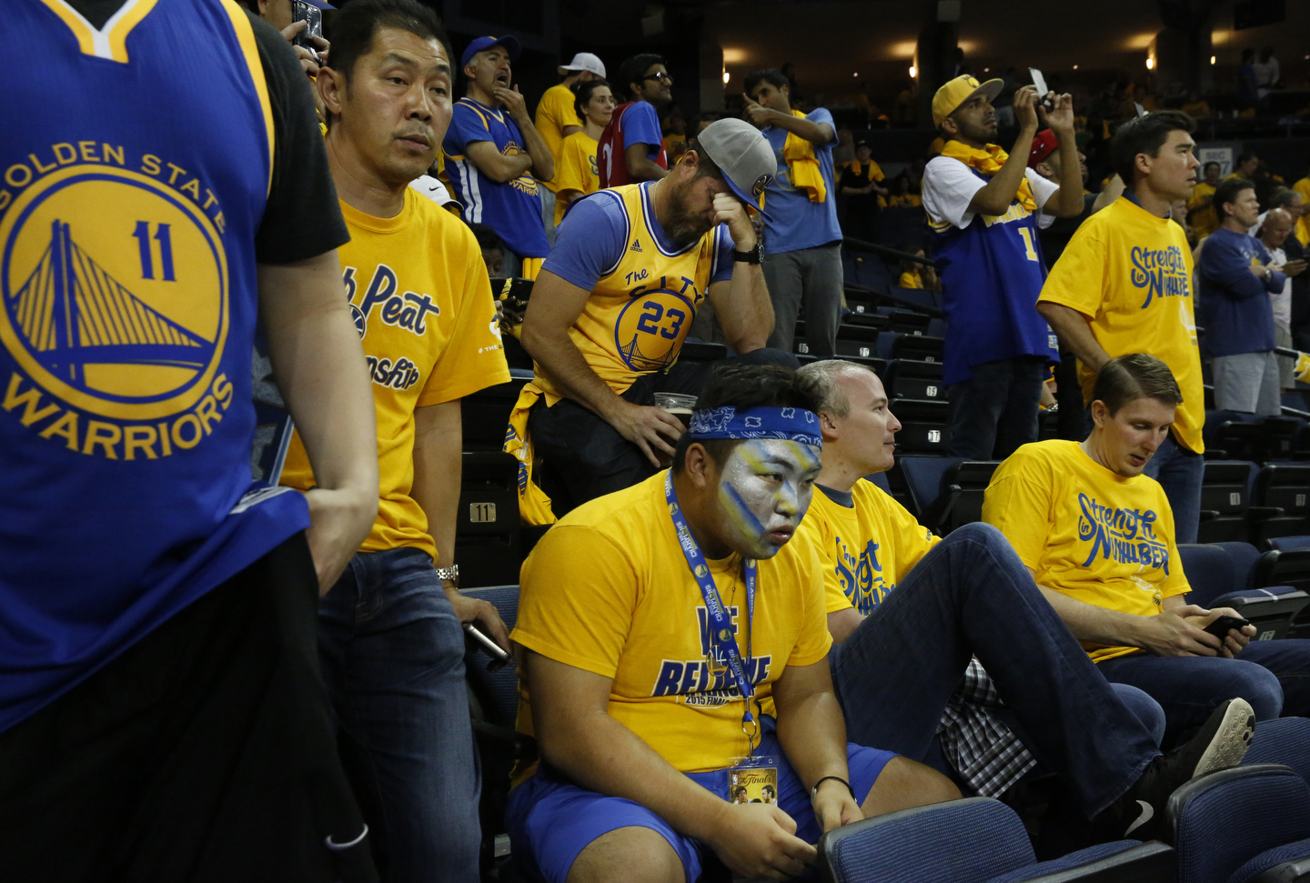 Warriors fans sit in stunned silence after the Warriors lost to the Cavaliers game 7 of the NBA Finals at the Oracle Arena June 19, 2016 in Oakland, Calif.